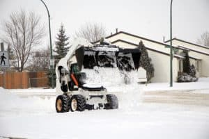 bobcat machine removing snow
