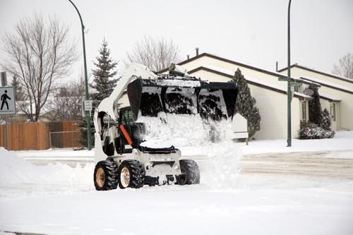 bobcat machine removing snow