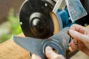 sharpening a lawn mower blade