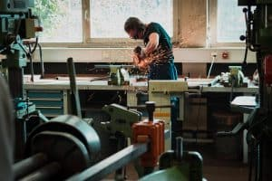 man cutting with saw